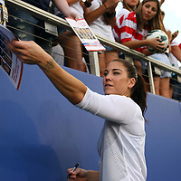 U.S. goalkeeper Hope Solo (1) signs autographs for fans after an international friendly soccer match between the United States Women's National soccer team and the Russia National soccer team at FAU Stadium on Saturday, February 8, in Boca Raton, Florida. The U.S. won the match by a score of 7-0. (AP Photo/Alex Menendez)