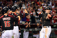 Apr 23, 2016; Phoenix, AZ, USA; Arizona Diamondbacks catcher Chris Herrmann (10) is congratulated by teammates after hits a three run home run in the eighth inning against the Pittsburgh Pirates at Chase Field. The Arizona Diamondbacks won 7-1. Mandatory Credit: Jennifer Stewart-USA TODAY Sports