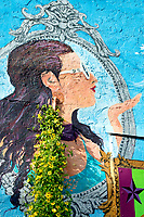 Woman blowing a kiss, painted on the side of a building in downtown Asheville.