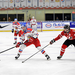 WHITBY, - Dec 16, 2015 -  Game #8 - Czech Republic vs. Canada East at the 2015 World Junior A Challenge at the Iroquois Park Recreation Complex, ON. Daniel Kurovsky #14 of Team Czech Republic skates with the puck while being pursued by Adam Smith #5 of Team Canada East during the first period.<br /> (Photo: Shawn Muir / OJHL Images)
