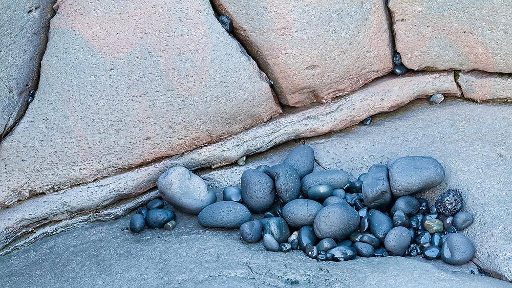 Black stones in a rock on Dritvik beach, Iceland