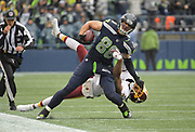 Nov 5, 2017; Seattle, WA, USA; Seattle Seahawks tight end Jimmy Graham (88) is tackled by Washington Redskins cornerback Josh Norman (24) during an NFL football game at CenturyLink Field.