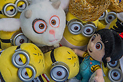 The new goat character and  Minions beach and prison characters from Despicable Me 3 on the Posh Paws stand - The London Toy Fair opens at Olympia exhibition centre. Organised by the British Toy and Hobby Association it is the only dedicated toy, game and hobby trade exhibition in the UK. It runs for three days, with more than 240 exhibiting companies ranging from the large internationals to the new start up companies.