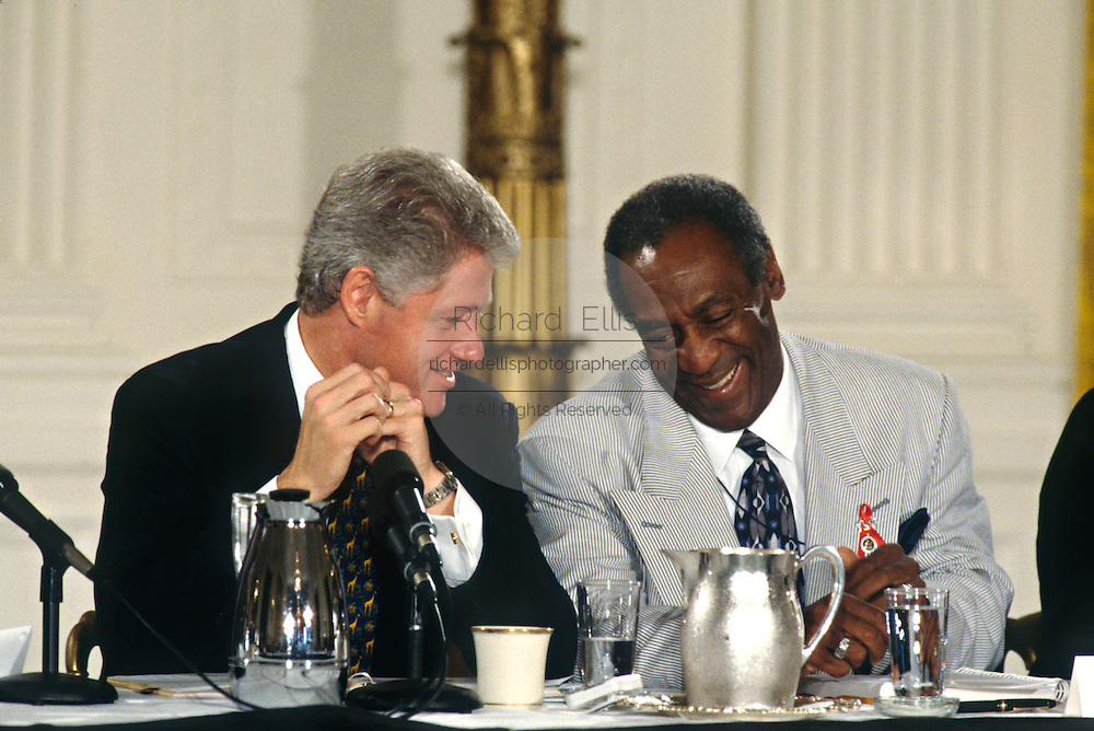 U.S. President Bill Clinton with comedian and actor Bill Cosby during an event in the East Room of the White House July 29, 1997 in Washington, DC.