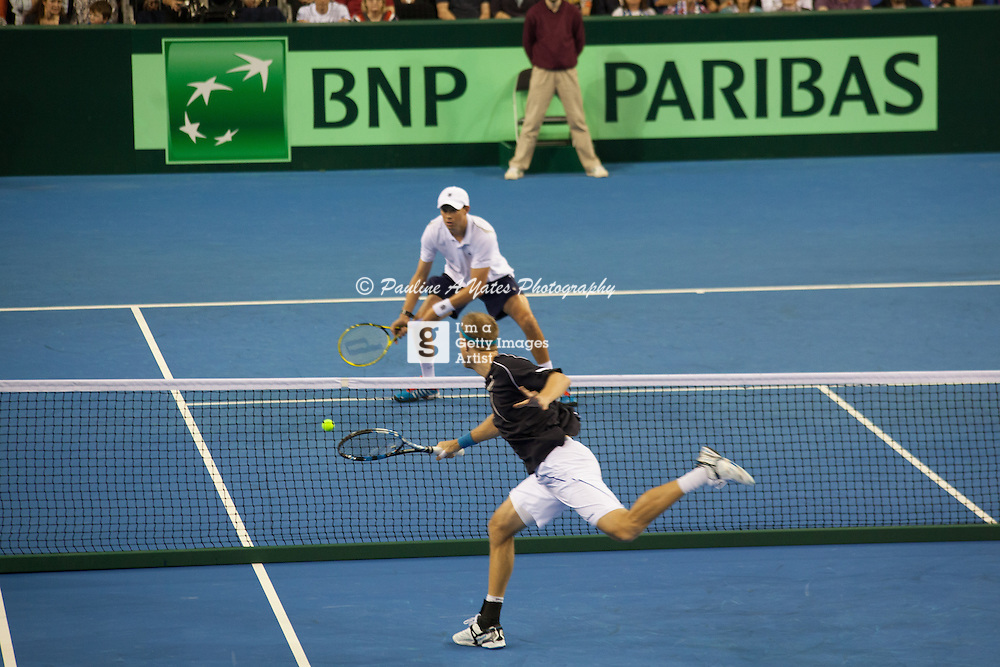 Dominic Inglot and Bryan battle it out at the net in the Davis Cup Doubles
