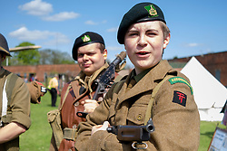 Reenactors from the  61st Reconnaissance Regiment Living History Group part of the British 50th Division wait to take part in a firing display <br /> <br />   04May 2015<br />   Image &copy; Paul David Drabble <br />   www.pauldaviddrabble.co.uk