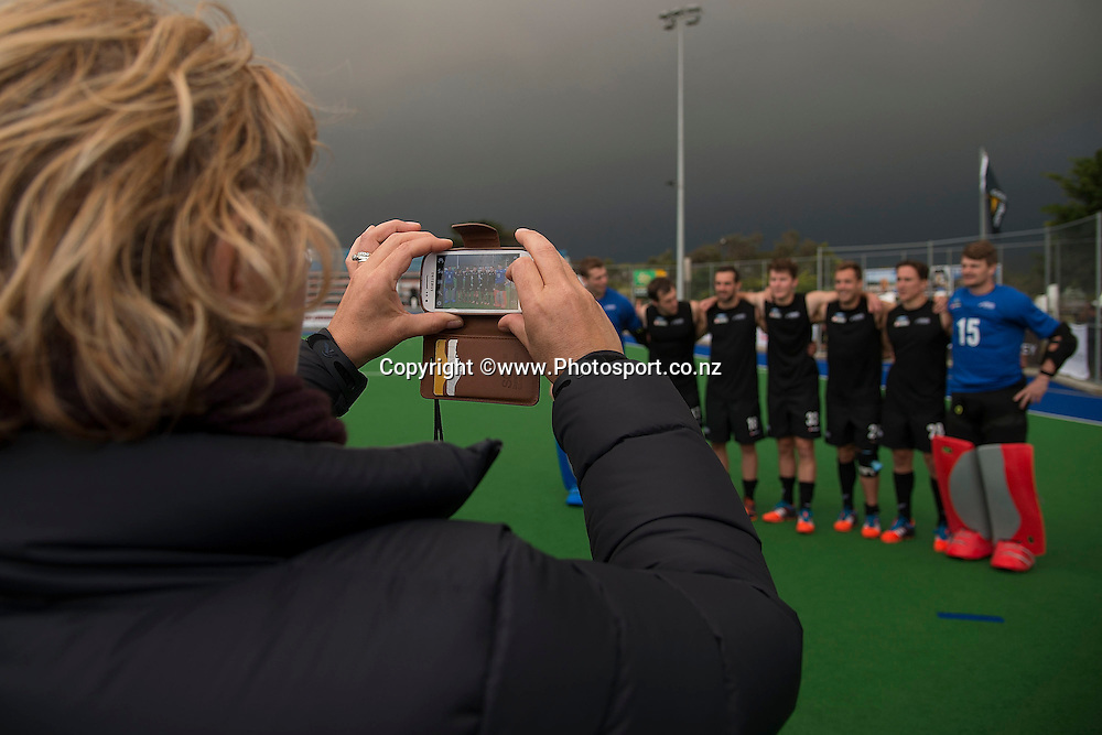 A fan takes a photo of New Zealand players during the Black Sticks Men v Japan international hockey match at the Coastlands Kapiti Sports Turf in Paraparaumu on Saturday the 22nd of November 2014. Photo by Marty Melville/www.Photosport.co.nz