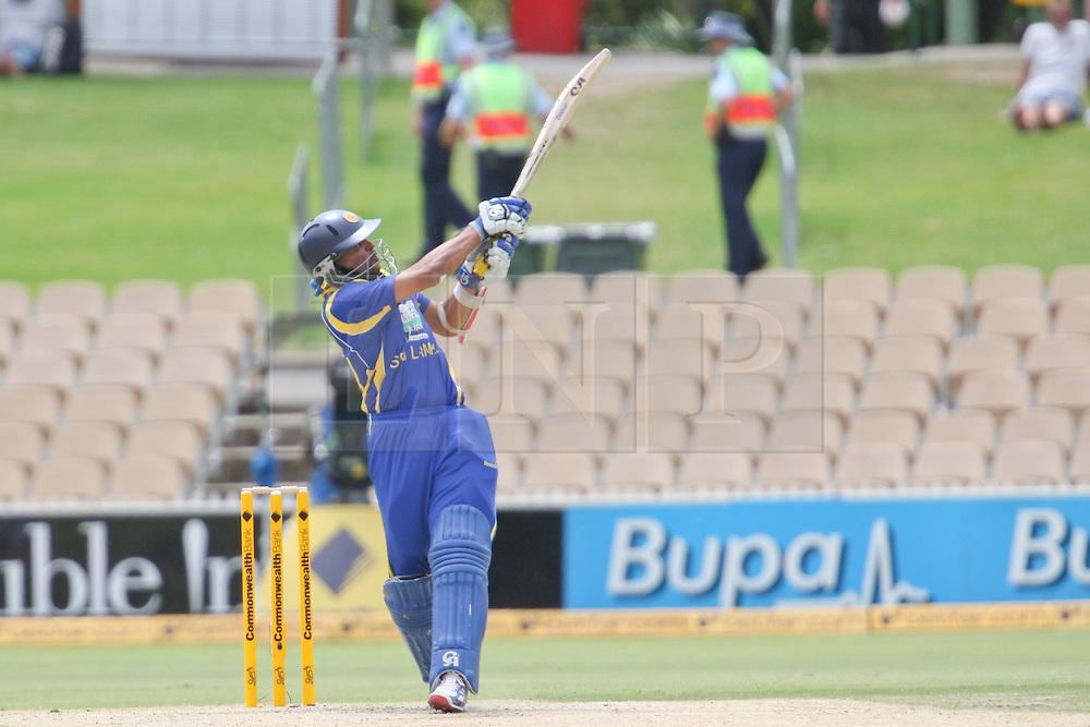 © Licensed to London News Pictures. 14/02/2012. Adelaide Oval, Australia. Sri Lankan batsmen Tillakaratne Dilshan plays a pull shot for 6 during the One Day International cricket match between India Vs Sri Lanka. Photo credit : Asanka Brendon Ratnayake/LNP