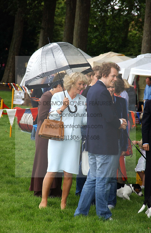 HRH The DUCHESS OF CORNWALL and her son TOM PARKER-BOWLES at the 3rd annual Macmillan Dog Day in aid of Macmillan Cancer Relief held at Royal Hospital Chelsea, London SW3 on 5th July 2005.<br /><br />NON EXCLUSIVE - WORLD RIGHTS