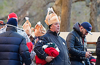 A man in a turkey-shaped hat looks for a seat at the Macy's Thanksgiving Day Parade.