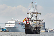 The Spanish Galleon Andalucia passes the Carnival Ecstasy cruise ship during the parade of sails kicking off the Tall Ships Charleston festival May 18, 2017 in Charleston, South Carolina. The festival of tall sailing ships from around the world will spend three-days visiting historic Charleston.