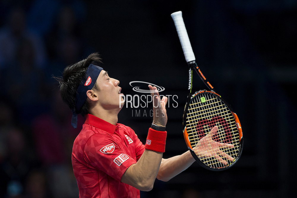 Kei Nishikori of Japan throws his racket during day six of the Barclays ATP World Tour Finals at the O2 Arena, London, United Kingdom on 18 November 2016. Photo by Martin Cole.