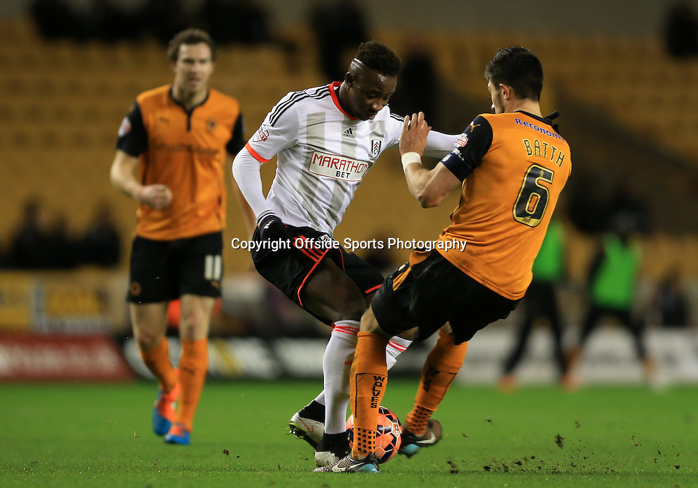 13th January 2015 - FA Cup - 3rd Round Replay - Wolverhampton Wanderers v Fulham - Danny Batth of Wolves battles with Moussa Dembele of Fulham - Photo: Simon Stacpoole / Offside.