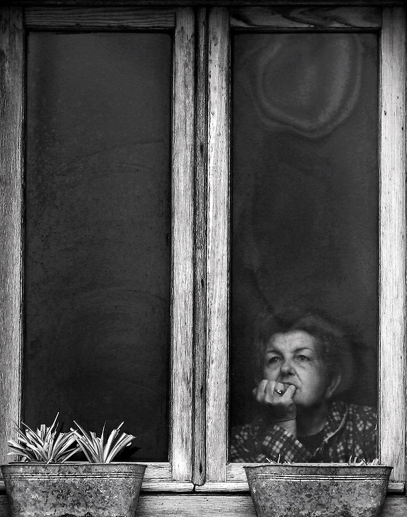 Woman looking outside a window in Italy.<br /> Limited Edition 3 of 10
