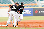 NEW TAIPEI CITY, TAIWAN - NOVEMBER 16:  Boss Moanaroa #8 of Team New Zealand rounds the bases after hitting a home run in the top of the eighth inning during Game 3 of the 2013 World Baseball Classic Qualifier against Team Thailand at Xinzhuang Stadium in New Taipei City, Taiwan on Friday, November 1, 2012.  Photo by Yuki Taguchi/WBCI/MLB Photos