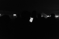 01 April 2016, Idomeni Greece - A refugee man at the mobile phone during the night.