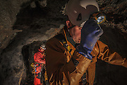 Deep in the Coniston copper mines in the Lake District, with the cave rescue team, for Petzl, France.