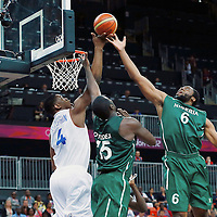 06 August 2012: France Kevin Seraphin vies for the rebound with Nigeria Ike Diogu and Olumide Oyedeji during 79-73 Team France victory over Team Nigeria, during the men's basketball preliminary, at the Basketball Arena, in London, Great Britain.