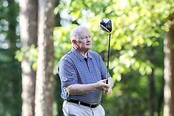 Jim Grobe tees off on the 10th hole during the Chick-fil-A Peach Bowl Challenge at the Ritz Carlton Reynolds, Lake Oconee, on Tuesday, April 30, 2019, in Greensboro, GA. (Karl L. Moore via Abell Images for Chick-fil-A Peach Bowl Challenge)