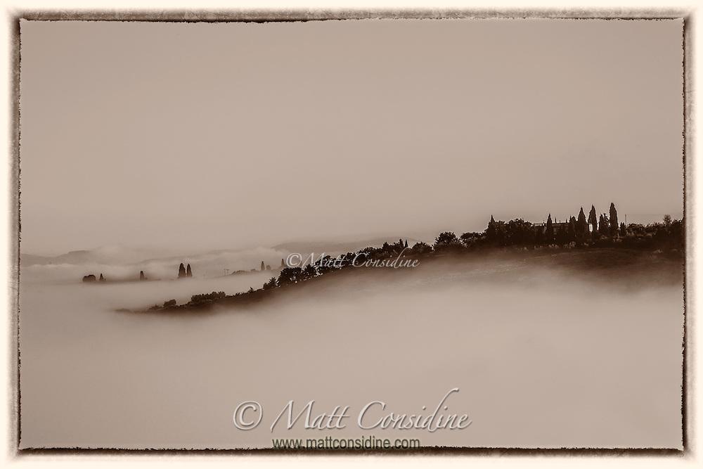 Early morning fog rolls down the valleys like water. (Photo by Travel Photographer Matt Considine)