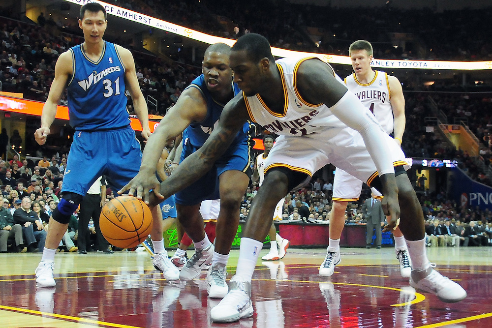April 13, 2011; Cleveland, OH, USA; Cleveland Cavaliers power forward J.J. Hickson (21) and Washington Wizards forward Kevin Seraphin (13) fight for a loose ball on the baseline during the second quarter at Quicken Loans Arena. Mandatory Credit: Jason Miller-US PRESSWIRE