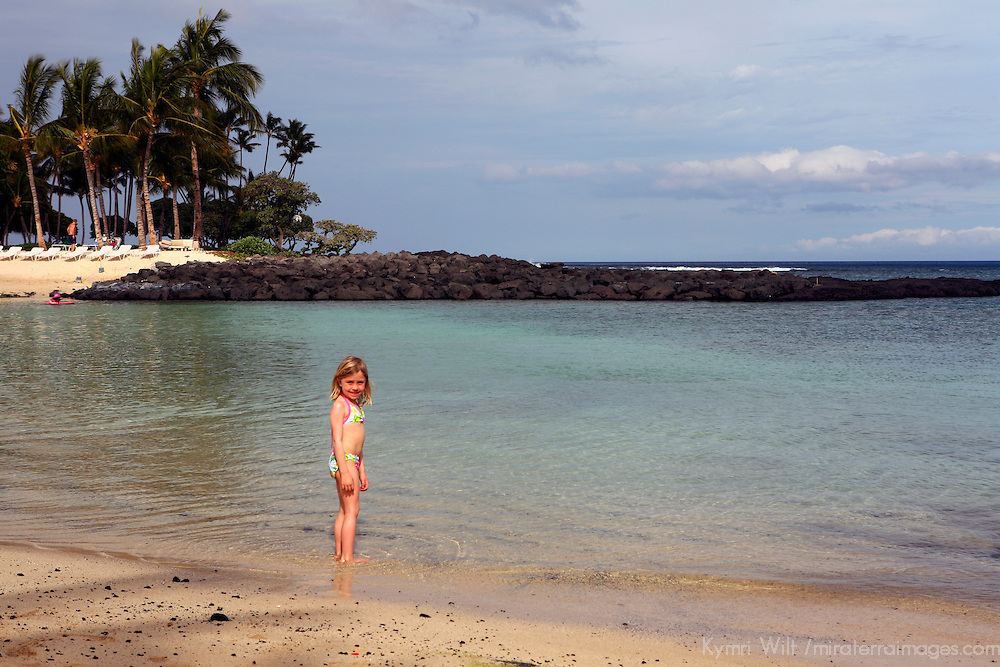 USA, Hawaii, Honolulu. Young girl on private beach at The Kahala Resort.