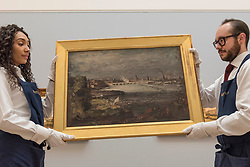 "© Licensed to London News Pictures. 01/12/2017. London, UK.  Technicians present ""The Opening of Waterloo Bridge"", circa 1819-20, by John Constable, (Est. GBP1.0-1.5m).  Preview of ""Masters of Light"", Sotheby's Old Masters Evening Sale which will take place on 6 December at Sotheby's, New Bond Street. Photo credit: Stephen Chung/LNP"
