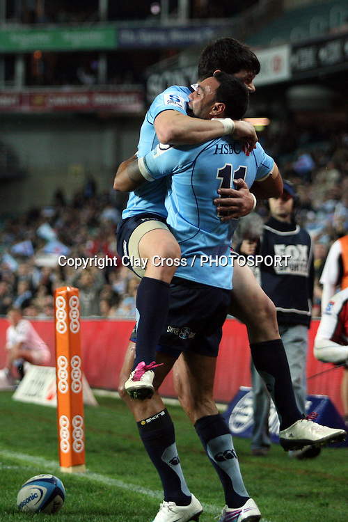 Tom Carter jumps on Sosene Anesi after his try. NSW Waratahs v Lions. Investec Super Rugby Round 14 Match, 21 May 2011. Sydney Football Stadium, Australia. Photo: Clay Cross / photosport.co.nz