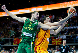 Jonas Valanciunas of Lithuania vs Predrag Samardziski of Macedonia during basketball game between National basketball teams of F.Y.R. of Macedonia and Lithuania at Quarterfinals of FIBA Europe Eurobasket Lithuania 2011, on September 14, 2011, in Arena Zalgirio, Kaunas, Lithuania. Macedonia defeated Lithuania 67-65. (Photo by Vid Ponikvar / Sportida)