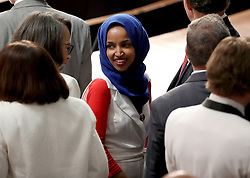 United States Representative Ilhan Omar (Democrat of Minnesota) with colleagues on the floor prior to United States President Donald J. Trump delivering his second annual State of the Union Address to a joint session of the US Congress in the US Capitol in Washington, DC, USA on Tuesday, February 5, 2019. Photo by Alex Edelman/CNP/ABACAPRESS.COM