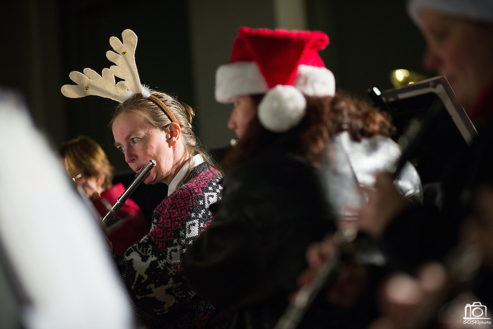 Cathy Hegstrom of Campbell wears reindeer antlers while performing with the Milpitas Community Concert Band during the Milpitas Christmas Tree Lighting Ceremony at Milpitas City Hall, in Milpitas, California, on December 1, 2013. (Stan Olszewski/SOSKIphoto)
