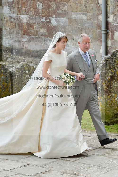 HRH The Prince of Wales with the bride the Hon.Alexandra Knatchbull at the wedding of the Hon.Alexandra Knatchbull to Thomas Hooper held at Romsey Abbey, Romsey, Hampshire on 25th June 2016