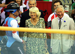 Image licensed to i-Images Picture Agency. 23/07/2014. Glasgow, United Kingdom. The Prince of Wales and Duchess of Cornwall share a joke with a cyclist during a visit to the velodrome at the Commonwealth Games in Glasgow  Picture by Stephen Lock / i-Images