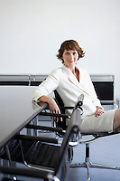 Business woman sitting beside conference table portrait