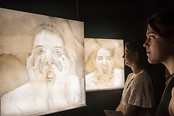 "© Licensed to London News Pictures. 28/06/2018. LONDON, UK. Visitors view ""5 Stages of Maya Dance"", 2018, by Marina Abramovich. Members of the public visit Masterpiece London, the world's leading cross-collecting art fair held in the grounds of the Royal Hospital Chelsea.  The fair brings together 160 international exhibitors presenting works from antiquity to the present day and runs 28 June to 4 July 2018.  Photo credit: Stephen Chung/LNP"
