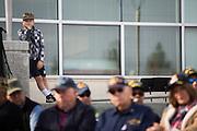 Kaleb Wilson, 11, watches the Veterans Day Ceremony at Milpitas City Hall's Veterans Plaza in Milpitas, California, on November 11, 2013. (Stan Olszewski/SOSKIphoto)