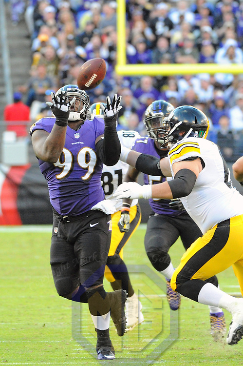 BALTIMORE, MD - NOVEMBER 06: Baltimore Ravens defensive end Timmy Jernigan (99) intercepts a pass in the third quarter against the Pittsburgh Steelers on November 6, 2016, at M&T Bank Stadium in Baltimore, MD. where the Baltimore Ravens defeated the Pittsburgh Steelers, 21-14.  (Photo by Mark Goldman/Icon Sportswire)