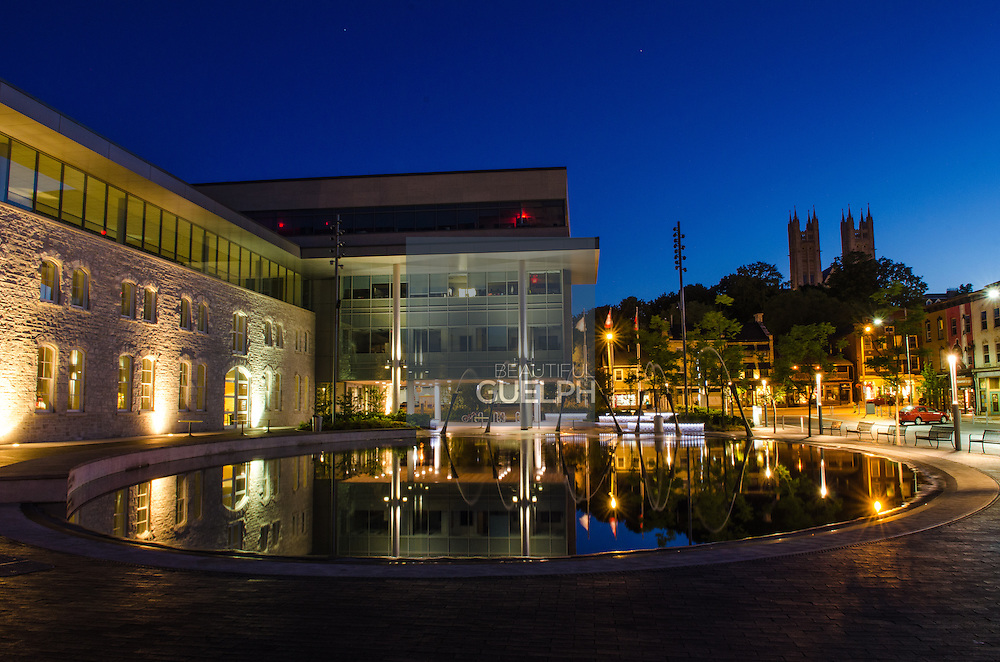 The New City Hall downtown Guelph, with splash pad and fountains.  Church and stars can also be seen.  Photo by Andrew Goodwin