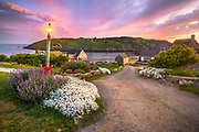 I was walking back from that incredible sunset at the lighthouse with Kimberly on our way our room at the Inn, and had to stop to capture this view looking down to the landing under a twilight purple sky. The Monhegan magic was in full effect.