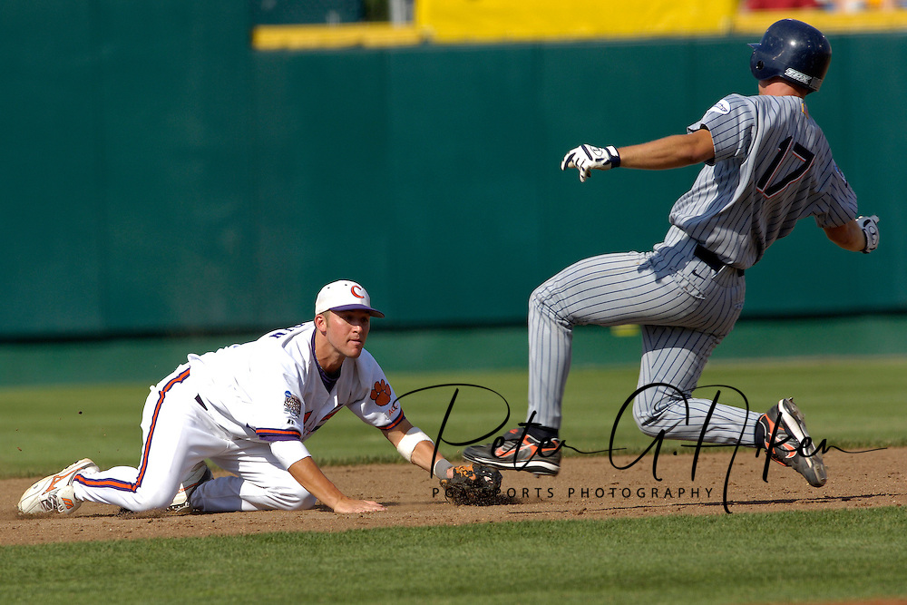 Clemson second basemen Taylor Harbin (L) gets ready to tag out Cal State Fullerton's David Cooper (17) trying to steal second base in the third inning.  Cal State Fullerton eliminated Clemson from the College World Series with a 7-6 win at Rosenblatt Stadium in Omaha, Nebraska, June 20, 2006.