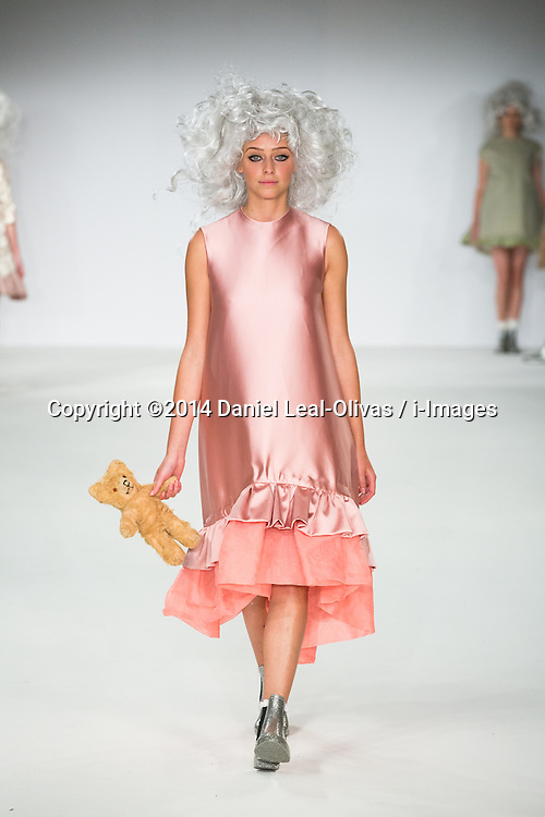 Graduate Fashion Week - Bath Spa & Norwich University of Arts. A model walks the runway from the Grace Dugdale collection during the Bath Spa University & Norwich University of the Arts show on the third day of the Graduate Fashion Week 2014 at The Truman Brewery, London, United Kingdom. Monday, 2nd June 2014. Picture by Daniel Leal-Olivas / i-Images
