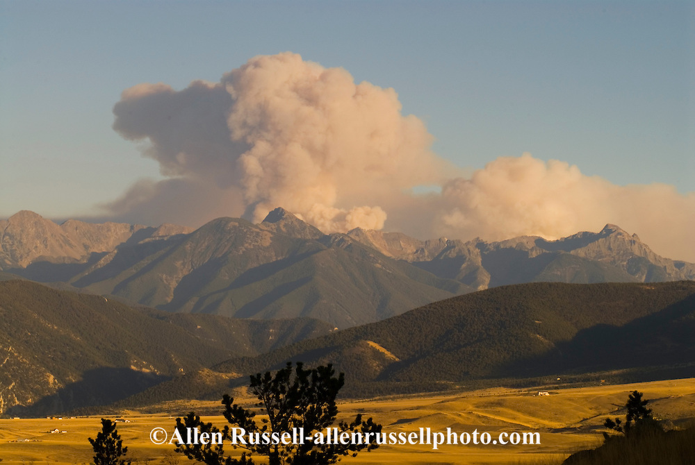 Huge plume of smoke rises from  forest fire above the Absaroka Mountain Range and Wilderness Area, Gallatin National Forest, south of Livingston Montana