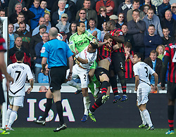 SWANSEA, WALES - Sunday, March 11, 2012: Manchester City's goal is disallowed for a foul on Swansea City's goalkeeper Michael Vorm during the Premiership match at the Liberty Stadium. (Pic by David Rawcliffe/Propaganda)
