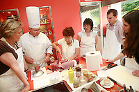 "Lenotre Ecole Culinaire, Paris,..short course - ""Return to the Market"" with Chef Jacky Legras..students cut the tuna..photo by Owen Franken for the NY Times..July 12, 2007......."