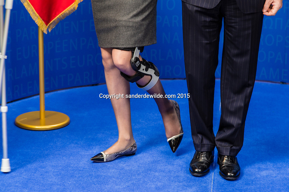 Brussels 25 february 2015 close up of the legs of  King Filip (M) and Queen Mathilde (L) from Belgian at the European parliament. Queen Mathilde is on  crutches she after having injured her left knee due to a fall.