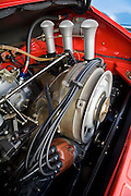 Image of a 1972 Porsche 911 with a flat 6 cylinder air-cooled motor, slide valves, MFI, engine, high butterfly, in Monterey, California, America west coast, property released