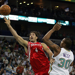 Luis Scola #4 of the Houston Rockets shoots over New Orleans Hornets forward David West  in the first quarter of their NBA game on March 19, 2008 at the New Orleans Arena in New Orleans, Louisiana.