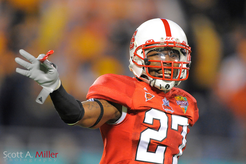 North Carolina State Wolfpack safety Earl Wolff (27) celebrates a fourth quarter fumble reovery during the Wolfpack's 23-7 win over the West Virginia Mountaineers in the 2010 Champs Sports Bowl at the Citrus Bowl on Dec. 28, 2010 in Orlando, Florida.