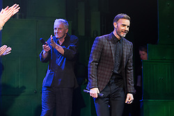 "© Licensed to London News Pictures . 12/01/2016 . Salford , UK . Writers GARY BARLOW (r) and TIM FIRTH (l) make a surprise appearance and Barlow performs in front of the audience at the Lowry Theatre ,  during the opening week of "" The Girls "" , a musical they wrote based on the story "" Calendar Girls "" , about a group of Women's Institute members in Yorkshire , who made a nude calendar . Photo credit : Joel Goodman/LNP"