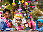"04 APRIL 2015 - CHIANG MAI, CHIANG MAI, THAILAND: Boys being ordained at the Poi Sang Long Festival in a parade through Chiang Mai. The Poi Sang Long Festival (also called Poy Sang Long) is an ordination ceremony for Tai (also and commonly called Shan, though they prefer Tai) boys in the Shan State of Myanmar (Burma) and in Shan communities in western Thailand. Most Tai boys go into the monastery as novice monks at some point between the ages of seven and fourteen. This year seven boys were ordained at the Poi Sang Long ceremony at Wat Pa Pao in Chiang Mai. Poy Song Long is Tai (Shan) for ""Festival of the Jewel (or Crystal) Sons.      PHOTO BY JACK KURTZ"
